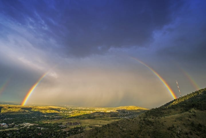 Rainbow Over Denver. Colorado Stormy Sky with Colorful Full Rainbow. Scenic View From the Lookout Mountain, Golden, Colorado, United States.
