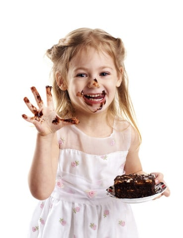 emotional portrait of a little girl with cake